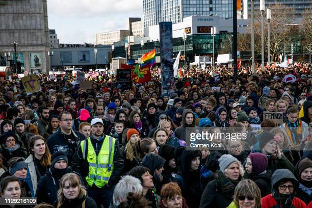 People attend a march for womens rights on International Women's Day on March 8 2019 in Berlin Germany Berlin has for the first time introduced a...