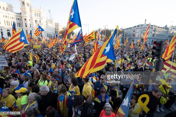 People attend a march under the slogan 'Auto determination is not a crime', in favor of Catalonian imprisoned politicians organized by several social...