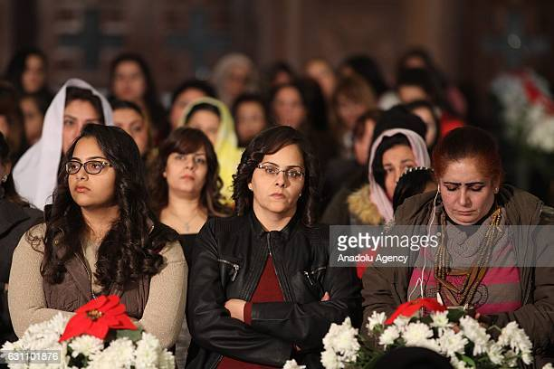 People attend a mass as part of celebrations of Jesus Christ's baptism and birth at St Mark's Coptic Orthodox Cathedral in Cairo Egypt on January 06...