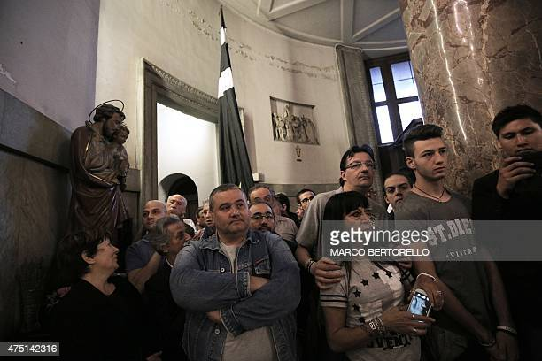 People attend a mass at Gran Madre di Dio church in Turin on May 29 to mark the 30th anniversary of the Heysel Stadium disaster. The Heysel Stadium...