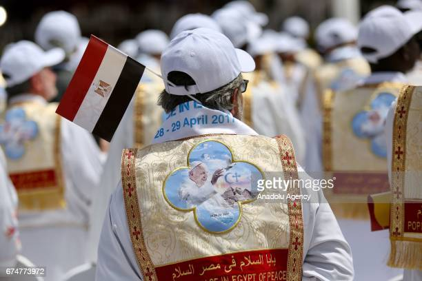 People attend a mass at the Air Defense Stadium celebrated by the Pope Francis in Cairo Saturday April 29 2017
