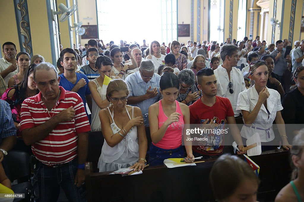 People attend a mass lead by Pope Francis at the Cathedral of Our Lady of Assumption on September 22, 2015 in Santiago de Cuba, Cuba. Pope Francis leaves for the United States after spending four days in Cuba.