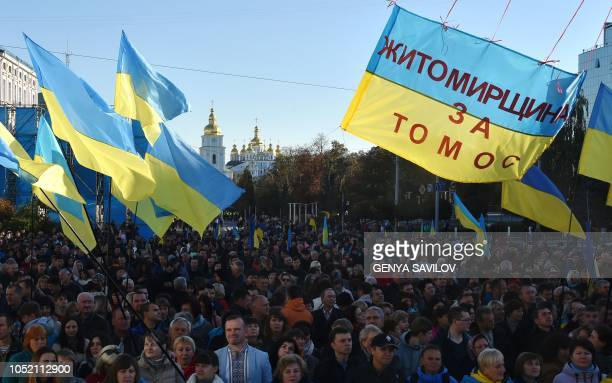 People attend a mass prayer in front of St Sophia Cathedral in Kiev on October 14 2018 Thousands of people gathered in central Kiev on Sunday to...