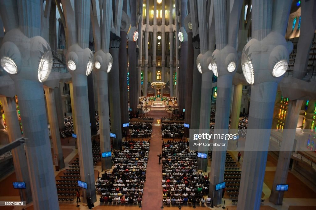 People attend a mass to commemorate victims of two devastating terror attacks in Barcelona and Cambrils, at the Sagrada Familia church in Barcelona on August 20, 2017. A grief-stricken Barcelona prepared today to commemorate victims of two devastating terror attacks at a mass in the city's Sagrada Familia church. As investigators scrambled to piece together the attacks which killed 14 people in all, Interior Minister Juan Ignacio Zoido said on August 19 the cell behind the carnage that also injured 120 and plunged the country into shock had been 'dismantled,' though local authorities took a more cautious tone. SORIANO