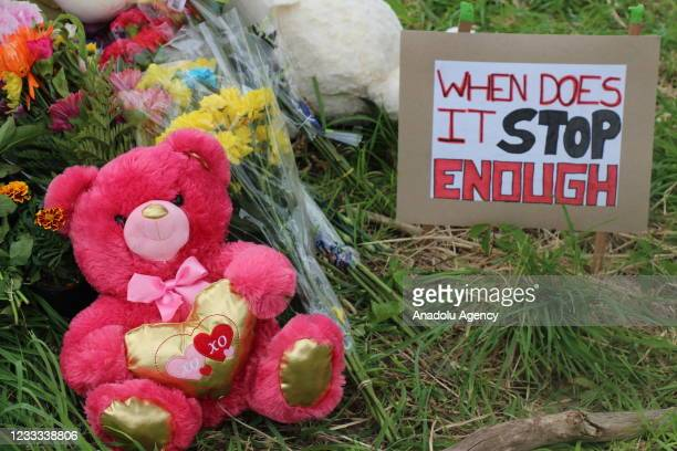 People attend a memorial at the location where a family of five was hit by a driver in London, Ontario, Canada on June 7, 2021. Four of the members...