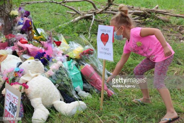 People attend a memorial ceremony at the location where a family of five was hit by a driver in London, Ontario, Canada on June 08, 2021. Four of the...