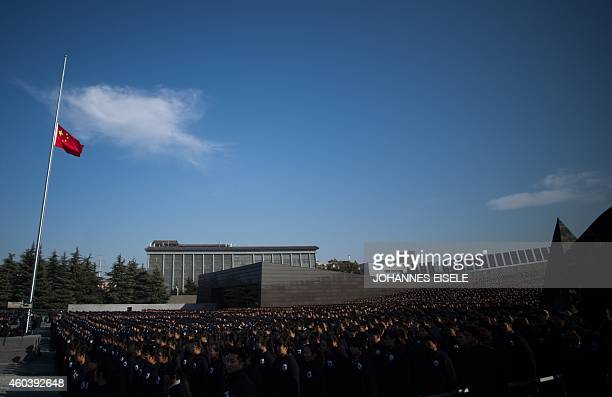 People attend a memorial ceremony at the Memorial Hall of the Victims in Nanjing Massacre by Japanese Invaders on China's first National Memorial Day...