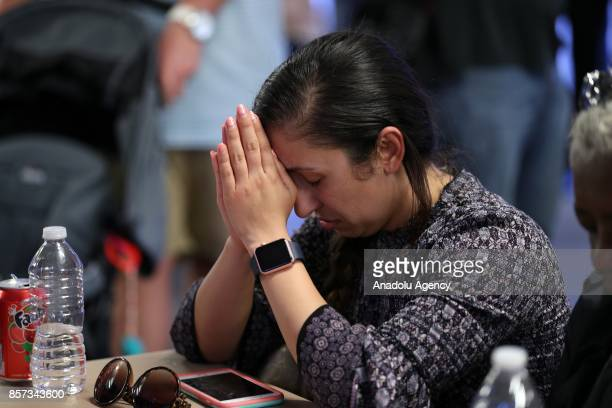 People attend a memorial for Las Vegas mass shooting victims who lost their lives after a gunman attack in Las Vegas NV United States on October 3...