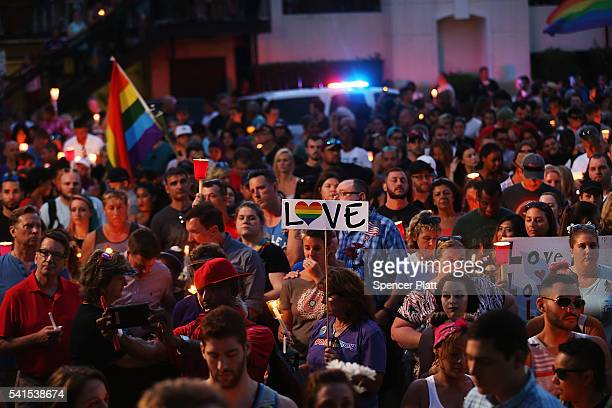 People attend a memorial service on June 19 2016 in Orlando Florida Thousands of people are expected at the evening event which will feature...