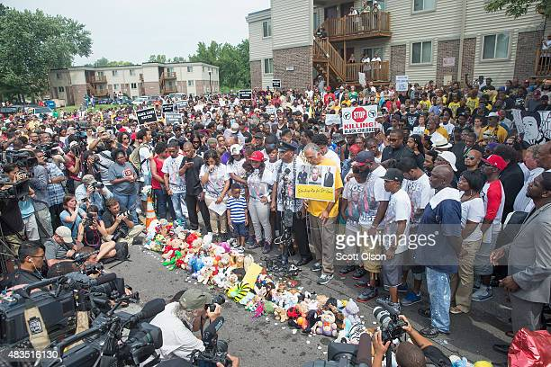 People attend a memorial service to mark the anniversary of Michael Brown's death on August 9, 2015 in Ferguson, Missouri. Brown was shot and killed...
