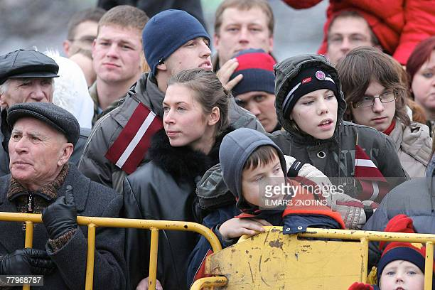 People attend a military parade celebrating the 89th anniversary of the proclamation of the Republic of Latvia in Riga 18 November 2007 AFP PHOTO /...