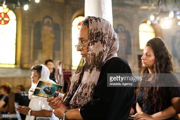 People attend a mourning ceremony at the Saint Peter and Saint Paul Coptic Orthodox Church in the Abbasiya district in the Egyptian capital Cairo on...