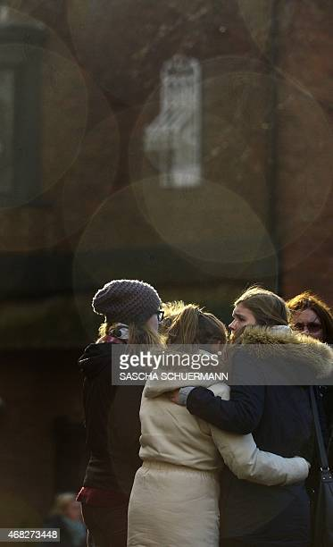 People attend a mourning service in front of the church St Sixtus in Haltern am See western Germany on April 1 from where some of the Germanwings...