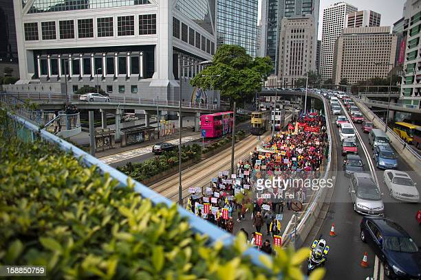 People attend a New Year's Day rally to express their support for Hong Kong's Chief Executive CY Leung prior to a demonstration for his resignation...