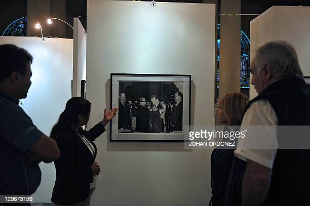 People attend a photography exhibition dedicated to former Guatemalan President Jacobo Arbenz on October 19 at the Culture Palace in Guatemala City...