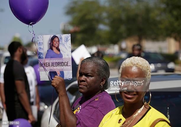 People attend a prayer vigil for Nykea Aldridge outside Willie Mae Morris Empowerment Center on August 28 2016 in Chicago Illinois Nykea Aldridge...