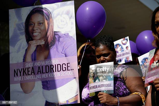People attend a prayer vigil for Nykea Aldridge outside Willie Mae Morris Empowerment Center on August 28 2016 in Chicago Illinois Nykea Aldridge a...