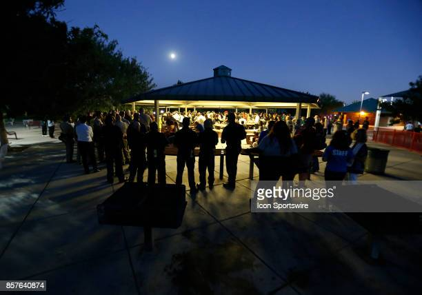 People attend a prayer vigil held at Mountain Crest Park for the victims of Sunday night's shooting on October 3 2017 in Las Vegas Nevada The gunman...