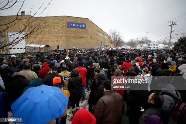 People attend a prayer vigil outside Henry Pratt Company on February 17 2019 in Aurora Illinois Six people including a gunman were killed and 5...