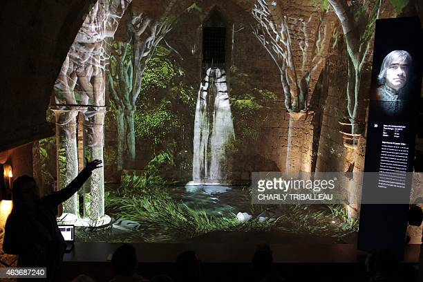 People attend a press visit on February 17 2015 of the Joan of Arc Historical Exhibition which will open on March 21 in Rouen northern France AFP...