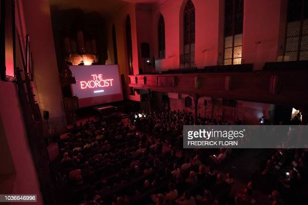 People attend a projection of the movie The Exorcist at the Saint Guillaume Protestant Church on September 20 2018 in the eastern French city of...