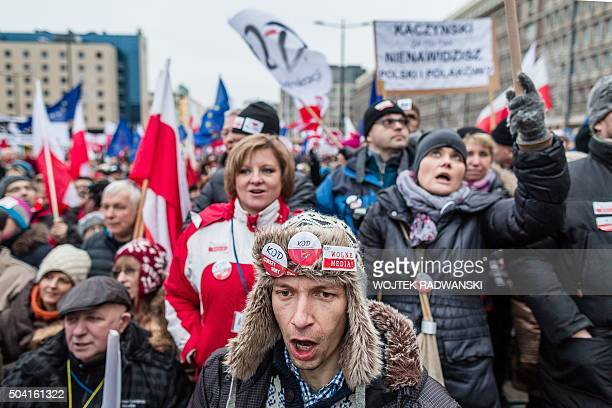 People attend a protest against a new media law in the center of Warsaw on January 9 2016 Since returning to power in October Poland's Law and...
