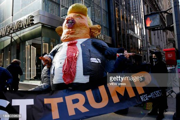 People attend a protest against the former U.S. President Donald Trump at Trump Tower on March 08, 2021 in New York. Trump is returning to New York...