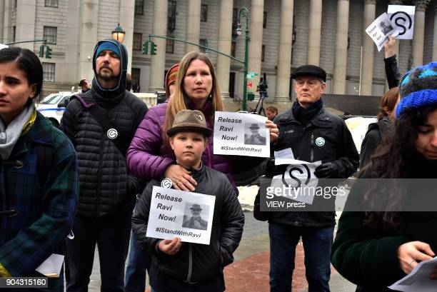 People attend a protest before a immigration rights activist Ravi Ragbir the executive director of the New Sanctuary Coalition was detained by ICE in...