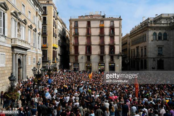People attend a protest in Barcelona on October 2 2017 a day after hundreds were injured in a police crackdown during Catalonia's banned independence...