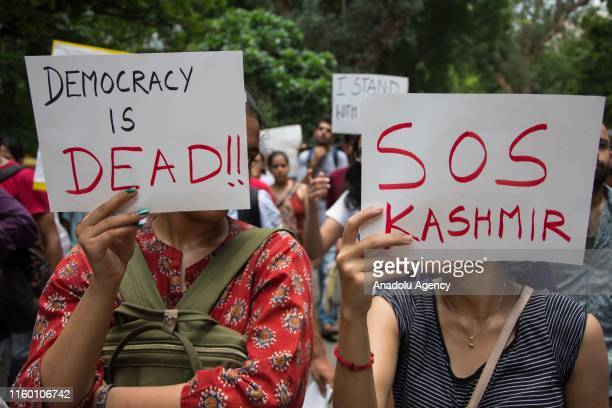 People attend a protest in solidarity with Kashmir over the removal of Article 370 and the forced shut down of all communication means in the valley...