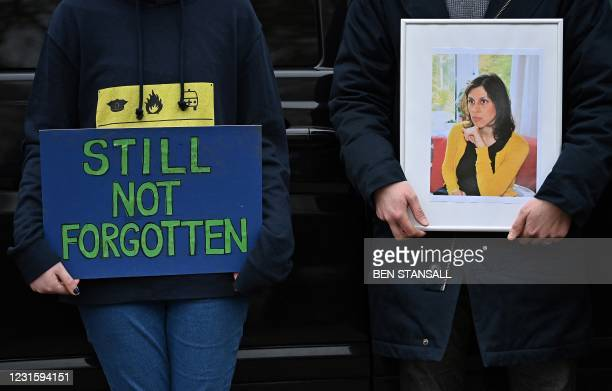 People attend a protest in support of British-Iranian aid worker Nazanin Zaghari-Ratcliffe jailed in Tehran since 2016, outside of the Iranian...