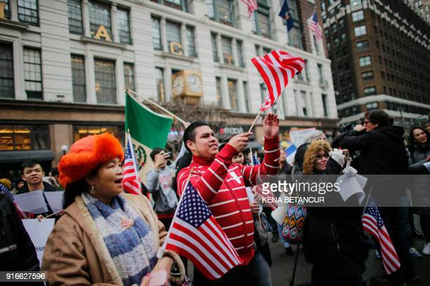 People attend a protest in support of immigration in herald Square on February 10 2018 in New York / AFP PHOTO / KENA BETANCUR