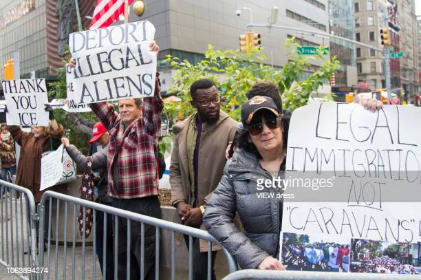 People attend a protest in support of thousands of migrant families who are traveling on a large caravan to reach the United States on November 3...