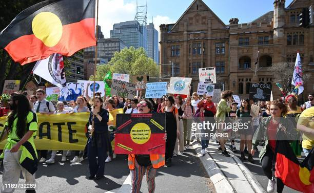 People attend a protest march as part of the worlds largest climate strike in Sydney on September 20 2019 Children in Australia and the Pacific...