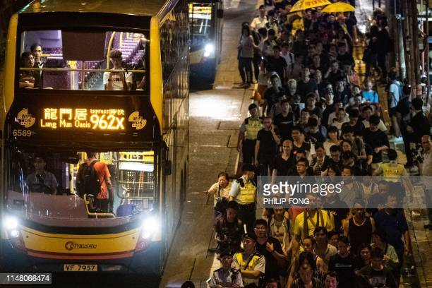 People attend a protest march to Chinese liaison office in Hong Kong late on June 4 after the candlelight vigil to mark the 30th anniversary of the...