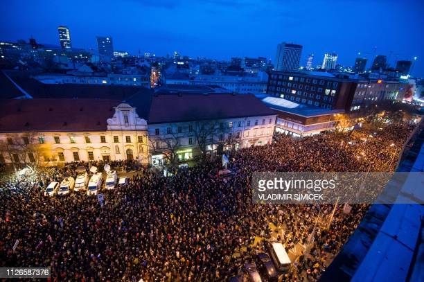 People attend a protest named For a Decent Slovakia on the first anniversary of the murder of journalist Jan Kuciak and his fiancee Martina Kusnirova...