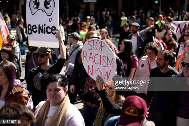 People attend a protest organized by leftwing group Campaign Against Racism and Fascism to counter rightwing groups 'Make Victoria Safe Again' protest