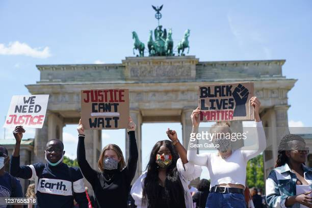 People attend a protest rally against racism in front of the Brandenburg Gate following the recent death of George Floyd in the USA on May 31, 2020...