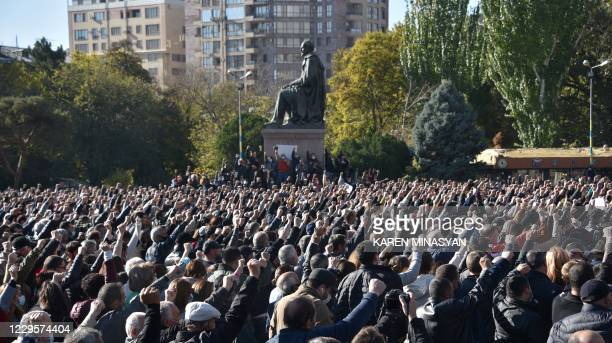 People attend a protest rally against the country's agreement to end fighting with Azerbaijan over the disputed Nagorno-Karabakh region outside the...