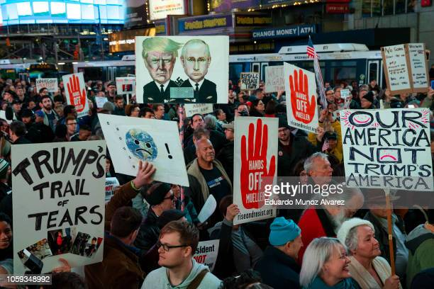 People attend a protest the day after President Donald Trump forced the resignation of Attorney General Jeff Sessions in Times Square on November 8...
