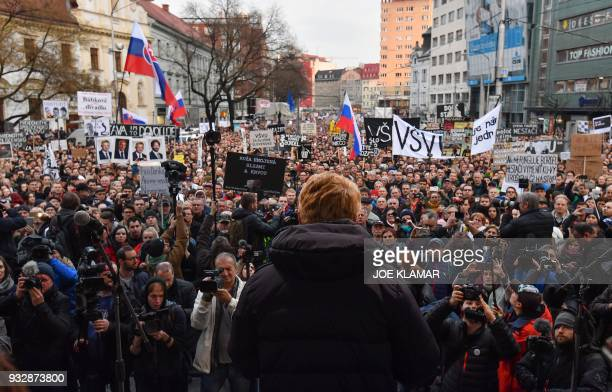 People attend a protest to demand new elections at the SNP Square after recent murder of Slovak journalist Jan Kuciak and his fiancee Martina...