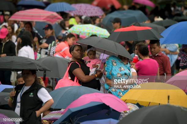 People attend a public event to promote the benefits of breastfeeding during the World Breastfeeding Week at a park in Bogota on August 3 2018...