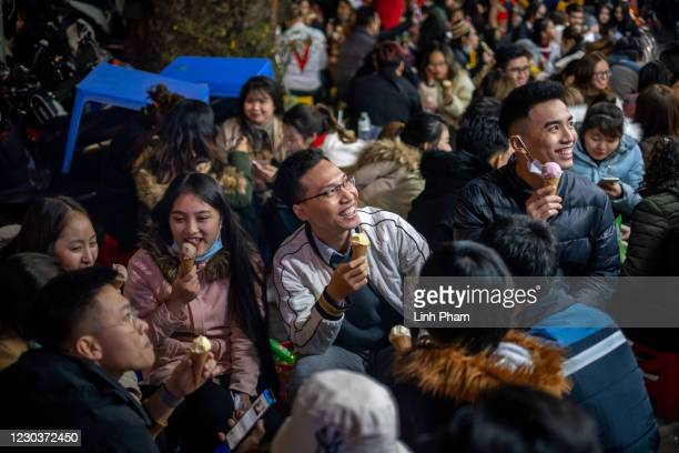 People attend a public New Year's Eve countdown party in the city center on January 01, 2021 in Hanoi, Vietnam. Vietnamese people celebrated New Year...
