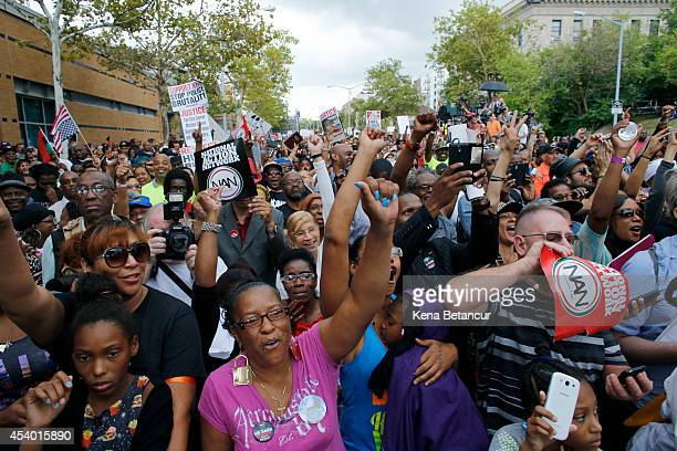 People attend a rally against police violence on August 23 2014 in the borough of Staten Island in New York City Thousands of marchers are expected...