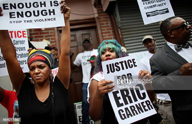 People attend a rally against police violence on August 23 2014 in the Staten Island borough of New York City Thousands of marchers are expected for...