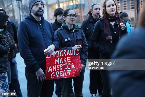 People attend a rally and vigil at Brooklyn's Borough Hall against President Donald Trump's immigration policies on April 9 2017 in New York City...