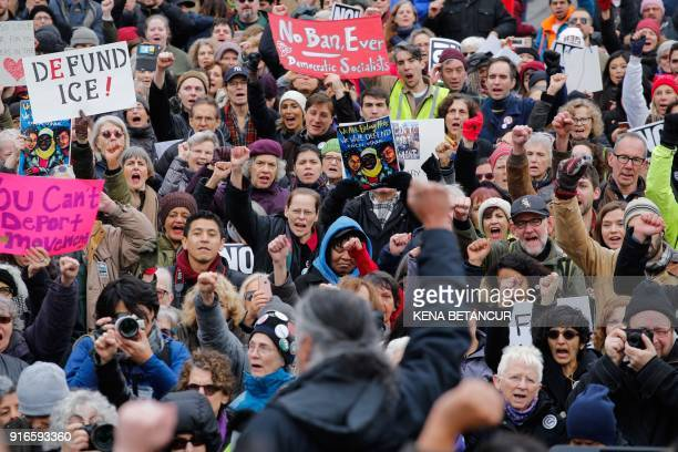 People attend a rally as Immigrant rights activist Ravi Ragbir speaks a day after he granted temporary stay of deportation in Foley Square on...