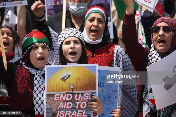 People attend a rally at Grant Park before marching through downtown to protest Israeli airstrikes in the Gaza Strip on May 16, 2021 in Chicago,...