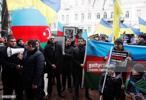 People attend a rally called Just the facts on the 25th anniversary of the Khojaly Massacre in front the Armenian Embassy in Kiev Ukraine on February...