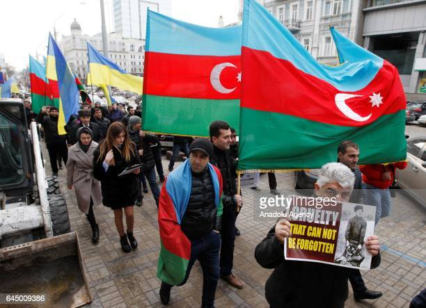 People attend a rally called 'Just the facts' on the 25th anniversary of the Khojaly Massacre in front the Armenian Embassy in Kiev Ukraine on...